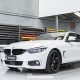BMW i Gran Coupe Gloss black Roof wrap and m style side skirts